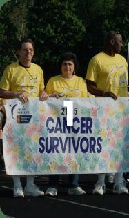 people holding a cancer survivors banner