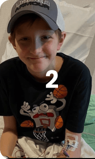 kid smiling while sitting on a hospital bed