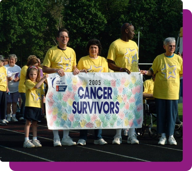 leia holding a banner with cancer survivors